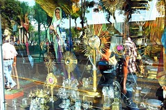 illusion, Window shopping for religious items, monstrance, statues, reflections, downtown central Guadalajara, Jalisco, Mexico