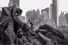 young climbers.. (Ken B Gray) Tags: kids rockclimbing centralpark blackandwhite bw nyc newyork manhattan skyline essexhouse