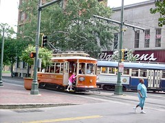 Orange 4 wheel Gomaco replica trolley. The Memphis Main Street Trolley. Memphis Tennesee. September 2007.
