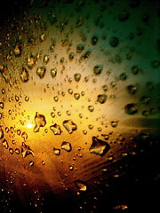 Racing Rain Drops (Kara Allyson) Tags: sunset sun window wet water car rain contrast race sunrise dewdrops rainbow driving class dew raindrops melt meltingice