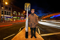 Dad, Cardiff (welshio) Tags: christmas uk longexposure nightphotography windows light people urban man streets men cars tarmac southwales wales portraits lights evening twilight europe alone traffic dusk flash cardiff illuminated christmaslights caerdydd glamorgan shops lonely lighttrails welsh tungsten roads towns luminous citycentre isolated mixedlighting lampposts dukestreet roadmarkings singleperson trafficisland mainroads lonelyperson theunforgettablepictures welshlandscapes saltmead mixedcolourtemperature gettyholidays2010