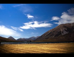 Lake Pearson just off SH73 (bkiwik) Tags: newzealand sky mountains nature clouds digital canon gold windy nz fields southisland pure aotearoa mothernature eos400d lakepearson