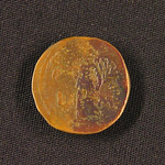 "<b>16 Reverse</b><br/> Coinage from Roman Egypt often followed Hellenistic minting practices, including adding regnal dates to the back of some coins to tell what year of the current ruler's reign were minted in. The Greek word for year was ETOYS, often replaced with an L, and followed by at least one letter indicating the date. Here they regnal date reads ""L Μ"", representing the 40th year of reign for Augustus, roughly AD10 - 11. Also seen on the reverse is the Greek goddess Nike moving towards the left. Nike was the literal personification of victory and was often depicted with wings, to emphasize that victory is fleeting. Nike is often depicted on coins of Greek origin.  Donated by Dr. Orlando ""Pip"" Qualley<a href=""http://farm3.static.flickr.com/2690/4351072897_efed280aa2_o.jpg"" title=""High res"">∝</a>"