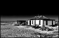 Quiet living BW (Paul Adames Noble) Tags: ocean life wood old uk sea blackandwhite building beach monochrome contrast living stones olympus erosion windswept southofengland dungeness remote shack hdr infared weatherd e520