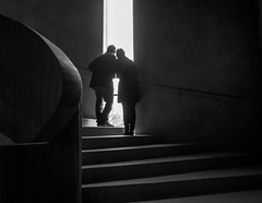 Couple at the window (Georgie Pauwels) Tags: stairs window couple staircase olympus candid streetphotography street darkness museum moment blackandwhite