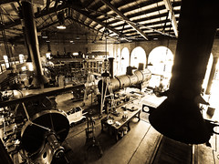 roundhouse III (contemplative imaging) Tags: camera railroad usa brown history ford industry shop museum sepia digital america industrial village mechanical antique michigan interior united north transport engine machine railway olympus steam machinery henry american repair transportation revolution locomotive states machines dslr greenfield tone 43 preservation dearborn evolt roundhouse weiser greenfieldvillage e510 servicing hfm fourthirds esystem hfmgv hfm090725ev95