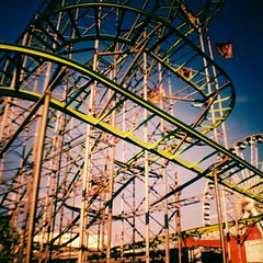 Web of steel (kevin dooley) Tags: park arizona film phoenix up metal analog 35mm lens fairgrounds lomo xpro lomography crossprocessed track fuji ride state steel web toycamera rail az down mini fair cage plastic velvia diana roller fujifilm rollercoaster 100 guide curve coaster thrill phx arizonastatefair dianamini