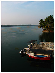 Over the bridge (Midhun Manmadhan) Tags: boats tranquility kerala backwater kappil