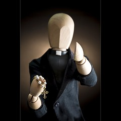 Spirituality (ANVRecife) Tags: wood macro canon toy religious toys miniature model catholic cross bokeh faith father religion woody thankful grateful spirituality monday minister woodmen rosarybeads woodmodel pries vallejos 40d conceptphotos macromondays tightdof anvrecife