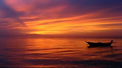 Red (kzembera) Tags: ocean travel sunset vacation orange holiday beach water colors digital canon reflections thailand boat photo asia seasia purple ripples kohphangan onlyyourbestshots boatandsunset