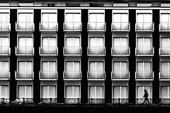 Walkin' on the edge of conformity (Effe.Effe) Tags: windows bw blur monochrome silhouette hotel pattern geometry bn finestre