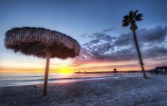The Sunset in San Clemente California (Stuck in Customs) Tags: ocean california travel sunset usa west color tree beach water clouds digital america umbrella photography coast pier blog high sand nikon san waves dynamic stuck pacific united north january relaxing scenic palm photowalk tropical imaging serene states sanclemente range leaning hdr trey travelblog customs 2010 ratcliff stuckincustoms d3x celemente
