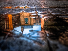 Reflexion...... (Mike Chen aka Full Time Taekwondo Dad) Tags: california usa reflection water rain stone puddle back losangeles los angeles echo lot olympus cobble cobblestone universal studios reflexion breathtaking ep1 universalstudiosbacklot breathtakinggoldaward breathtakinghalloffame