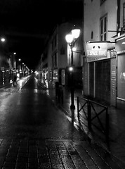 shadow in the night - une ombre dans la nuit (Pendore) Tags: street shadow bw storm france rain silhouette vent wind pluie nb nuit laval reflets lumires tempte rflections lastsunday 53000 at7am pendore lovely~lovelyphoto lighstreet ruedugnraldegaulle dimancherdernier