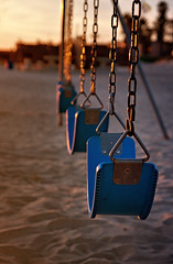 swinging in the light (Maureen Bond) Tags: ca blue light sunset beach metal golden chains sand dof swings maureenbond