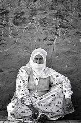 Woman from Midyat (piotr.pedziszewski) Tags: street old woman wall sweater sitting looking rings granny turkish nene midyat etnic