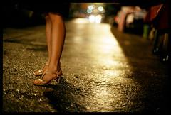 Night walk (Lefty Jordan) Tags: road street light shadow hk film wet girl night hongkong closed dof dress floor legs market bokeh slide heels tungsten fujichrome fg20 50mmf12 t64