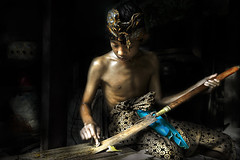 Pande (Master Blacksmith) Series - Nyoman Okasuwarna (Mio Cade) Tags: travel boy shirtless bali man metal indonesia fire photography iron father son master heat sweat sword kris tradition endurance ubud alloy skill knive pande badung masterofmetal committeeofartistists