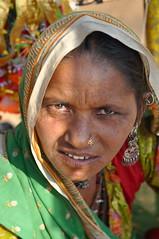 puzzled I (Shreyans Bhansali) Tags: portrait woman india face indian fair camel pushkar rajasthan puzzled mela camelfair pushkarcamelfair2009