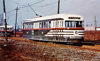 Chicago Surface Lines 1936 built PCC electric streetcar # 7017 on Private right of way on West 63rd Place east of the South Narragansett  loop. Chicago Illinois USA. 1948.