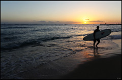 Surfer and sunset, Waikiki beach (rickz) Tags: ocean sunset reflection beach water night hawaii evening surf pacific waikiki oahu dusk walk surfer tide honolulu waikikibeach settingsun waikikisunset
