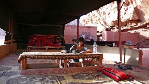 catching up on my travel journal in a bedouin tent, wadi rum
