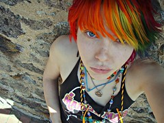 Rock wall flower (Megan is me...) Tags: blue red portrait orange color green colors smile fashion rose yellow self hair effects photography one diy clothing crazy rainbow eyes colorful neon pretty colours russell mckay bright unique awesome meg violet plum megan style nuclear special clothes kind fishbowl iguana jerome colored mayhem punky striped bleached dyed napalm sfx rosered megface meganisme bleachednapalmorange meganyourface