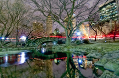 bridge and pond, new york city (mudpig) Tags: nyc newyorkcity longexposure bridge newyork reflection tree ice skyline geotagged cityscape centralpark plazahotel hdr ight thepond sherrynetherland mudpig stevekelley avonbuilding