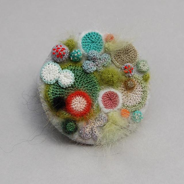 Moldy madness brooch