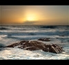 Sailing into sunset... (Chantal Steyn) Tags: ocean africa light sunset sea panorama sun seascape storm water landscape southafrica nikon rocks waves ship vessel capetown coastal filter handheld seapoint westerncape d300 cokin gndfilter nohdr vertorama 1685mm