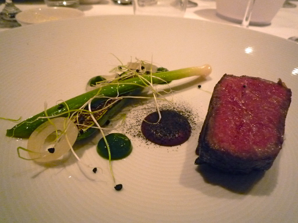 Wagyu sirloin with black olive, Earl Grey ash, burnt cucumber and onion
