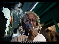 The Bioscope Punk (Shabbir Ferdous) Tags: blue light red portrait people man color colour green alley photographer shot bokeh cigarette smoke attitude dhaka tone bangladesh canonef2470mmf28lusm bangladeshi bioscope canoneos5dmarkii shabbirferdous oldtowndhaka shakharibazaar wwwshabbirferdouscom shabbirferdouscom