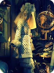 she is the quiet one. the Raven is by her side, even tho you cannot see him, he is there. (Manhattan Girl) Tags: nyc urban white rabbit mannequin window beautiful fashion vintage globe soft poetry display manhattan 5thavenue surreal lovely