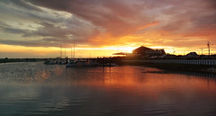 Sunset At The Marina (Philipp Klinger Photography) Tags: ocean light sunset shadow sea summer sky panorama usa sun house lake west reflection beach water backlight clouds america marina ma boat warm ship yacht massachusetts united north dramatic july atlantic panasonic cape states dennis amerika cod philipp fz50 counterlight klinger nordamerika mywinners dcdead