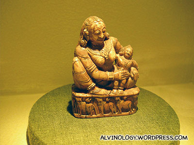 Rotund figurine with a baby