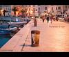 Promenade at night (Explored for Nikon D3000) (Michele Cannone) Tags: sunset italy night port walking lights harbor boat barca mare 50mm14 porto promenade lungomare puglia romantico lampioni passeggiata trani pinnaclephotography