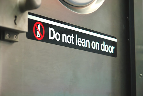 do not lean on door - nyc subway