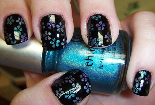 Lethal polish konad nail art i destroyed it an hour after completion base is sally hansen pacific blue snowflakes are from plate m59 and i used konad white special polish for prinsesfo Gallery