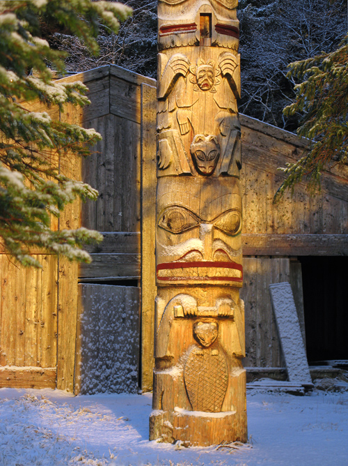 snow on totem in front of Chief Son-i-Hat Whale House, Kasaan, Alaska