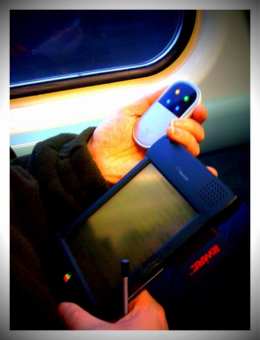 I sat beside a chap on the train who was checking his email on one of these... Apple Newton... using MiFi: