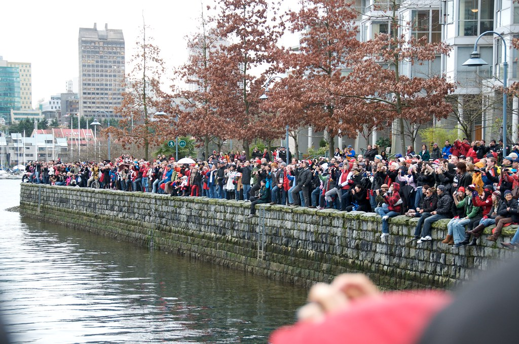Crowd Watches the Olympic Torch Arrive at Yaletown
