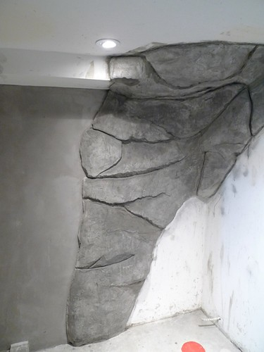 Here's a little carved rock, venetian plaster steam shower ...