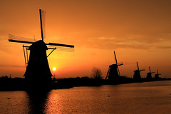 Sunrise at Kinderdijk (ionut iordache) Tags: morning sky orange sun holland water clouds sunrise canon nederland thenetherlands windmills mills canonef2470mmf28lusm kinderdijk zuidholland southholland greatphotographers 3000v120f nieuwlekkerland canoneos50d canon50d theunforgettablepictures platinumheartaward 100commentgroup dragondaggeraward saariysqualitypictures platinumpeaceaward mygearandme mygearandmepremium mygearandmebronze mygearandmesilver mygearandmegold outstandingromanianphotographers mygearandmeplatinum mygearandmediamond romanianflicker greaterphotographers greatestphotographers