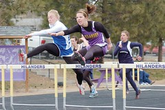 Brea Ribeiro of Burns races to a first place finish in the 100m  hurdles. (Photo by RANDY PARKS)