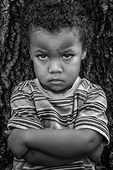 Angry Boy (J.J. Taylor) Tags: boy portrait people blackandwhite bw white black cute male monochrome face childhood kids youth children person sadness blackwhite kid mood crossing child sad cross arms emotion serious anger attitude angry pout africanamerican emotional mad ethnic emotions jai unhappy moods ethnicity pouting crossed concepts unhappiness peopleofcolor