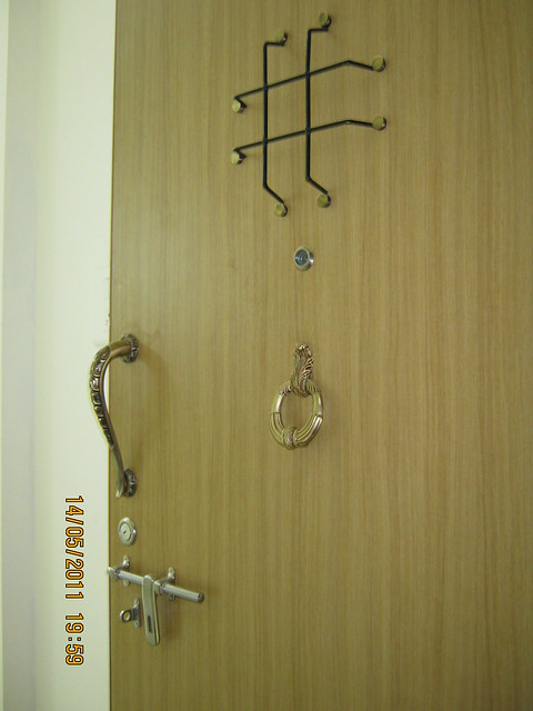 Decorative main entrance door of a 2 BHK Sample Flat in Om Developers' Tropica, Blessed Township at Ravet PCMC, Pune 412 101