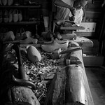 Wood carver, Puy du Fou, France.