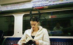 Horned Queen of Darkness on the Underground reads spell for making photographers vanish (deepstoat) Tags: people colour film 35mm underground tube horns yashicat5 devil autaut deepstoat
