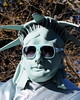 Lady Liberty's Gentleman (Holly Ford Brown) Tags: nyc newyorkcity portrait man tourism sunglasses star costume funny paint humor working makeup dressup statueofliberty decorate thebigapple thenewlife onstilts holidays2009
