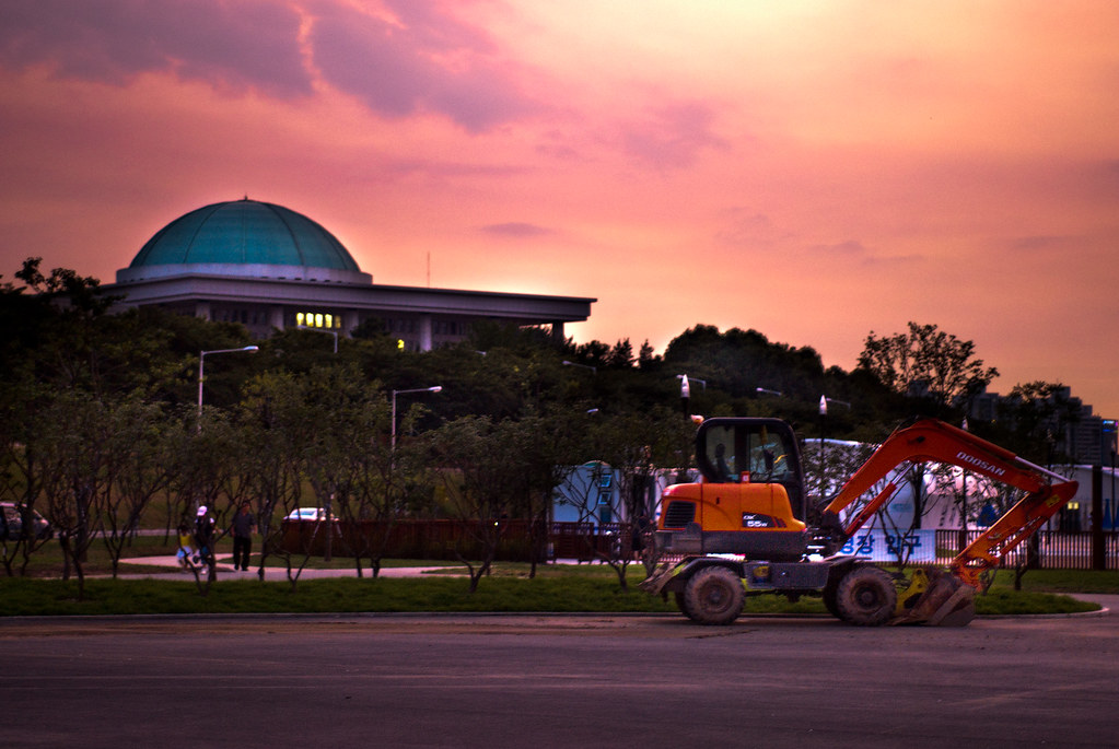 national assembly and backhoe
